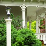 Notice the decorative cutout patterns in the panels of the porch railing