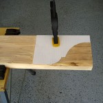 Position the template - you can secure it to the board with a clamp to hold it in place while you draw the outline